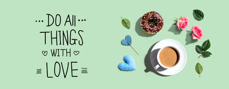 Do all things with love message with a cup of coffee and a donut - flat lay