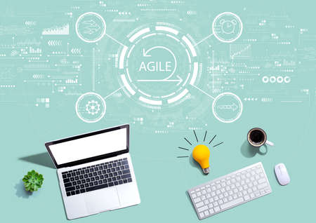 Agile concept with computers with a light bulb Фото со стока