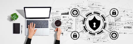 Cyber security theme with person using laptop computer
