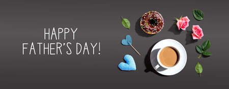 Happy fathers day message with a cup of coffee and a donut Standard-Bild