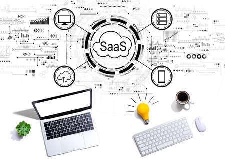 SaaS - software as a service concept with computers with a light bulb