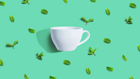 Fresh mints with tea cup overhead view