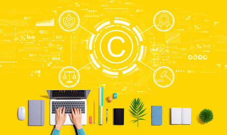 Copyright concept with person using a laptop