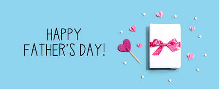 Happy Fathers day message with a gift box and hearts