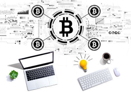 Bitcoin theme with computers with a light bulb Standard-Bild