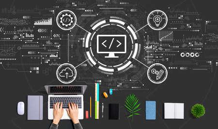 Web development concept with person using a laptop Standard-Bild