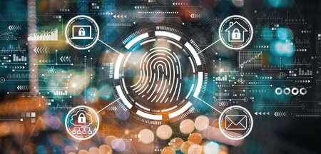 Fingerprint scanning theme with blurred city lights