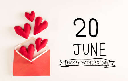Fathers Day message with red heart cushions Standard-Bild