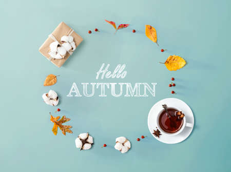 Hello autumn message with autumn leaves and tea