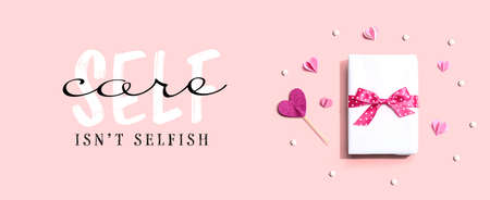 Self care is not selfish message with a gift box and hearts
