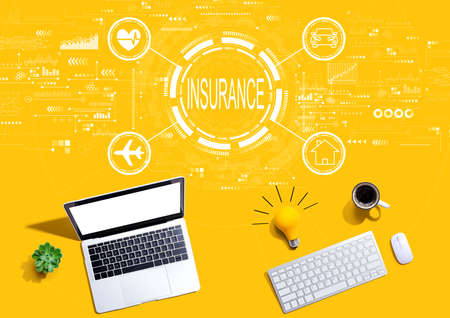Insurance concept with computers with a light bulb