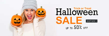 Halloween sale with woman holding pumpkins