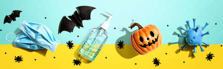 Masks and sanitizer bottle with Halloween objects 版權商用圖片