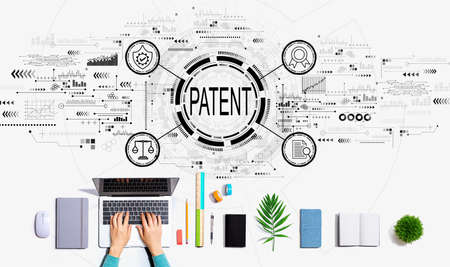 Patent concept with person using a laptop 版權商用圖片