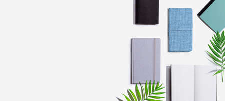 Collection of notebooks with tropical leaves 版權商用圖片