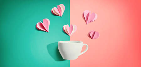 Coffee cup with paper craft hearts