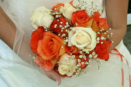 cradling: Bright Wedding Bouquet of Roses