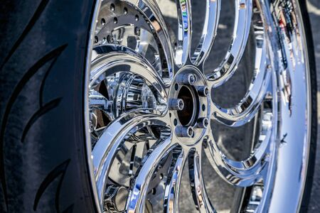 Chromed car wheels with disc brakes, close-up Stock fotó