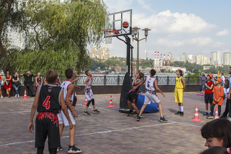 Rostov-on-Don, Russia-September 25, 2018: embankment of Don river; celebration of the city day, children are engaged in basketball; editorial