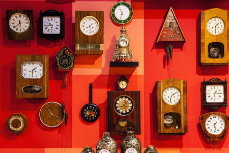 Russia, Kamensk-Shakhtinsky - October 13, 2017: museum of the USSR,  many wall clocks on a red wall, Free open.