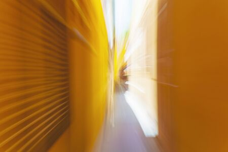 Narrow streets of Italy, yellow buildings, blurred motion
