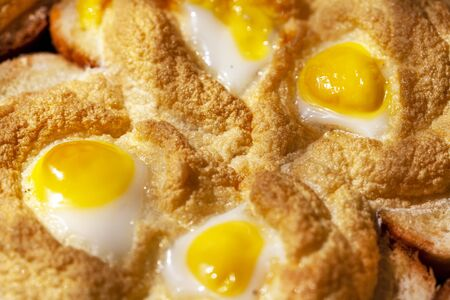Breakfast, fried eggs with quail eggs with fried whipped whites on bread