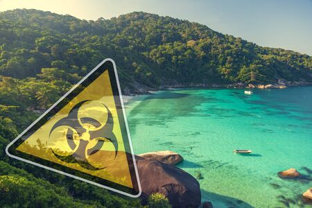 Quarantine action in Thailand. Sign biological danger on beach Similan islands.