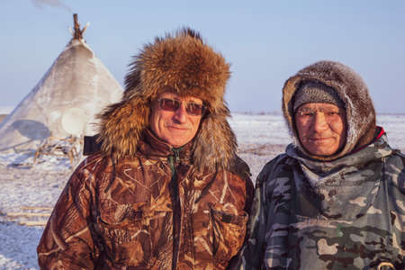 Tundra, Yamal Peninsula, far north, reindeer pasture, dwelling of northern peoples, assistant reindeer breeder,  the men  in national clothes, 新聞圖片