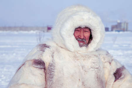 Tundra, Yamal Peninsula, far north, reindeer pasture, dwelling of northern peoples, portrait of a shaman in a white fur coat
