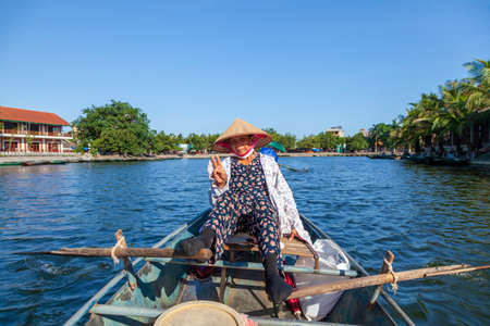 Vietnamese women ride tourists in boats controlled by legs