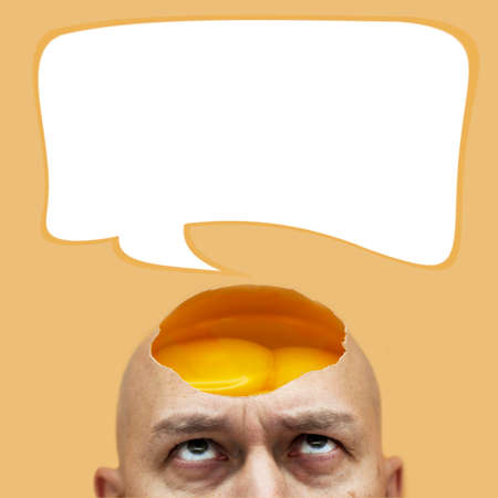 The concept of thought in my head, there are ideas. On a bald head, a man has an open, raw, shelled egg. Space for printing, footnote over your head. The idea of making a new recipe