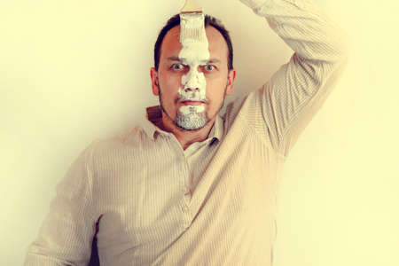 Good luck concept. A white strip in life, a line is drawn on the face of a man with white paint