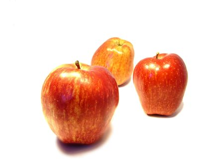 three red apples on a white background... photo