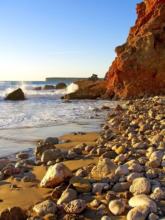 pebles: Seashore at Tonel beach on the Algarve near Sagres with many rocks on the sand.