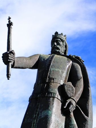 iii: D. Afonso III statue located on the old city walls on Faro, Portugal