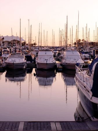 vilamoura: Marina view of Vilamoura near Quarteira City, Algarve, Portugal, with its many cool boats, at sunset.