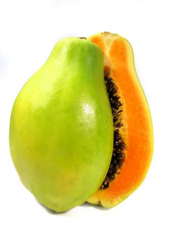 Papaya fruit section sliced on half isolated on a white background. Stock Photo