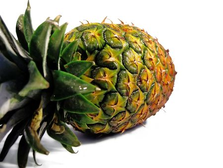 horizontal position: Single pineapple on a horizontal position isolated on a white background. Stock Photo