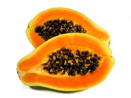 Papaya fruit sliced on half isolated on a white background. Stock Photo