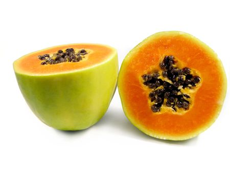 Papaya fruit cut in half isolated on a white background.