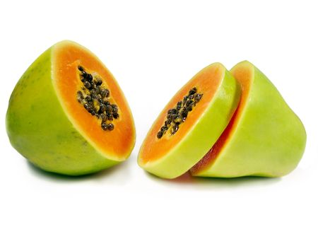 Papaya fruit sliced through the middle isolated on a white background.