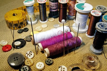 spreaded: Several sewing material spreaded over the table. Stock Photo
