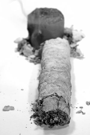 inhaled: Angle perspective of ash of some dying end cigar.