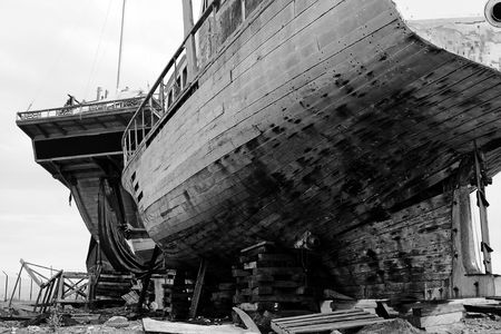 View of two abandoned and broken old boats on a shipyard. photo