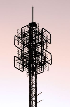 Silhouette view of a cellphonecommunications tower structure. photo