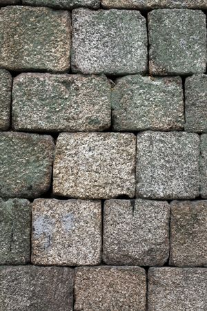 flaws: Close view of an old castle textured stone wall.