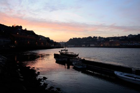 View of the river Douro dividing Oporto and Gaia cities at the dawn of day in the north of Portugal. photo