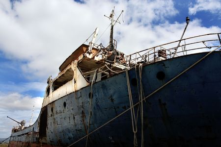 View of an abandoned ship on the docks. photo