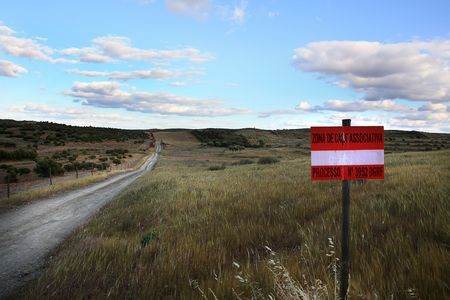 View of a dirt road on the countryside region with a hunting ground sign on Algarve/Portugal. Stock Photo - 6295203