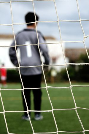 View of a goalkeeper player on the field of a soccer game.